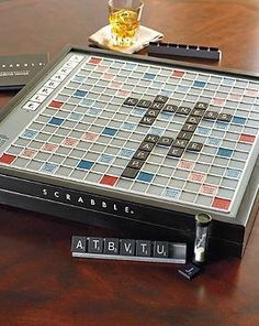 Worthy of any setting, the Scrabble: Frontgate Deluxe Edition is housed in a handsome black hardwood case accented with silver foil and features a smooth-rotating game board with raised grid to hold tiles in place for an enjoyable game experience.