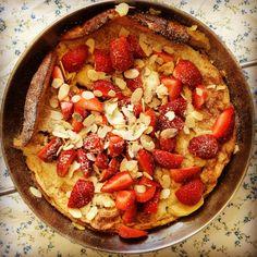 caramelised banana dutch pancake with fresh strawberries