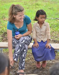 Cambodia 2014 — It has been an incredibly busy couple of weeks,... UWS Volunteer Milly with a stern child in Cambodia  :) (from Milly's Tumblr)