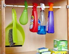 Hang spray bottles from a rod to keep them upright. It can be hard to keep spray bottles from fallin. Organisation Hacks, Storage Organization, Storage Ideas, Kitchen Organization, Garage Storage, Jewelry Organization, Storage Solutions, Cool Ideas, Cleaning Hacks