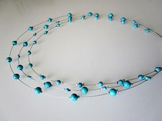 Aquamarine Hawlite beads floating necklace vision necklace
