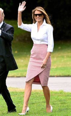 """<p>Looking chic as she readied to leave for Poland, the political force wore <a href=""""http://fave.co/2tShDcv"""" target=""""_blank"""">Valentino cropped, wide-leg trousers</a> while carrying a Hermes crocodile black bag. </p>"""