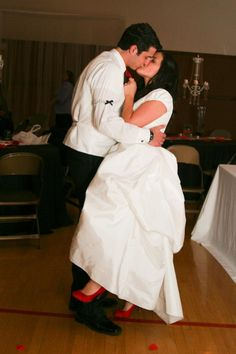 What a wondeful couple to work with,  they are so in love...  Colors: Black, Red and White  Photographer: Spencer Taylor Rice