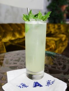 The Gin Gin Mule - Gin, Lime Juice, Simple Syrup, Ginger Syrup, Mint, Club Soda.