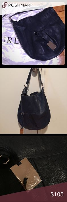MAKE AN OFFER! FURLA Navy Blue W/dust bag GREAT CONDITION Furla dark dark blue hobo shoulder bag w/silver accent. Gently worn - only shown in the well aged leather. One scratch at bottom - please look at photos! MAKE AN OFFER- I am open! Furla Bags Hobos