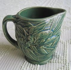 """1930's McCoy Pottery Green Stoneware 5"""" Raised Relief Pitcher. This one features a bird, berries and leaves pattern.  It is 5"""" high and 4.5"""" in diameter.  The condition is excellent."""