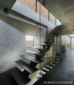 Center-stringered with glass balustrade
