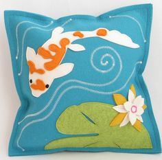 Our decorative koi fish and lily pad pillow is turquoise seafoam green felt with appliqued lily pads and flowers. Enjoy our koi fish pillows as