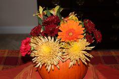 Autumn floral arrangement turns into something special when arranged inside a fresh pumpkin. Flowers last longer- I swear!