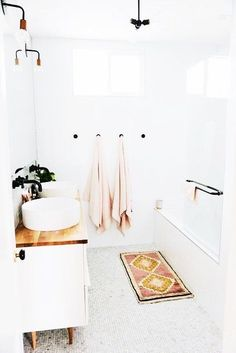 white bathroom with rug