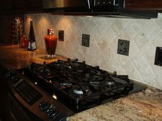 Granite counter tops with tumbled marble backsplash with metal decos! Check out our selection! http://jptilewholesalers.com/Natural-Stone-Tile_c4.htm http://jptilewholesalers.com/Insert-Tile_c45.htm