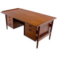 Danish Modern Teak Executive Desk Designed by Arne Vodder | From a unique collection of antique and modern desks at http://www.1stdibs.com/furniture/storage-case-pieces/desks/
