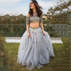 Luxe gray sequined lehenga perfect for an Indian wedding or formal occasion. A-line skirt with a sequined top including a built in bra.