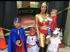 Kourtney Kardashian and her family as superheroes for Halloween. Shoutout to North's unicorn costume!