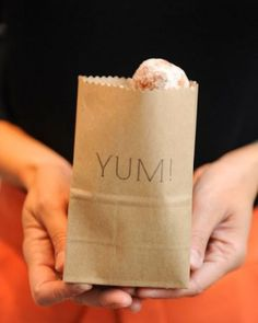 Simple rubber-stamped kraft-paper bags for treats | Reception