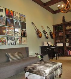 A man cave for the musical genius! Add your favorite albums and instruments to your walls for a personal touch. Pair with comfortable seating, tan carpeting and a music area, of course.
