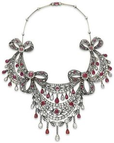 AN ANTIQUE DIAMOND AND RUBY NECKLACE. Designed as an old mine-cut diamond festoon necklace, decorated with four old mine-cut diamond and ruby pierced bows, suspending an old mine and rose-cut diamond foliate swag, bezel-set with a series of cushion and oval-cut rubies, suspending a fringe of bezel-set pear-shaped diamonds and rubies, to the knife-edge collet-set diamond neckchain, mounted in silver-topped gold, circa 1860, numbered.