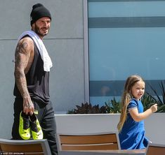 Daddy's girl: Following the workout, it looked like Harper was excited to get outside to p...