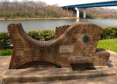 Art along trails: Chattanooga,  Brick sculpture at Fishing Park on the Tennessee Riverpark in Chattanooga, TN. C. B. Robinson Bridge is in the background