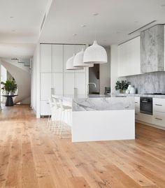 Light and airy white modern kitchen with white oak flooring and spiral staircase. Decor Style Home Decor Style Decor Tips Maintenance Modern Coastal, White Coastal Kitchen, Coastal Style, Timber Flooring, Formal Living Rooms, Kitchen Design, New Homes, House Design, Interior Design