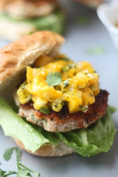 Blackened Chicken Burgers with Warm Mango Salsa by cookingforkeeps #Burgers #Chicken #Mango