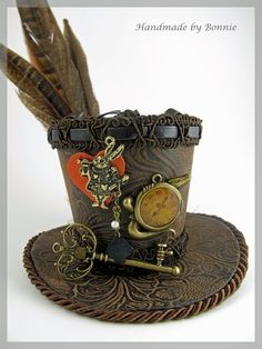 Mad Hatter Tiny Top Hat - Mini Top Hat - Alice in Wonderland. $70.00, via Etsy.