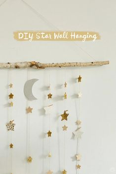 Create your own dreamy room decor with a DIY star wall hanging Create a DIY star wall hanging using a tree branch, twine, and paper stars. Add glitter or wrapping paper for dreamy room decor. Paper Wall Hanging, Diy Hanging, Diy Wall Art, Diy Wall Decor, Diy Girl Room Decor, Diy Crafts Room Decor, Paper Room Decor, Kid Decor, Decor Room