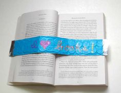 Weighted bookmark - made with duct tape and pennies (or washers) - for hands free reading. I had a patient last summer with cubital tunnel syndrome who this would have been good for. She said her fingers would get numb when holding her book open.