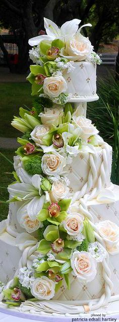 A nautical rope nod with a beautiful orchid & roses cascade wedding cake by New Rosebud. Not crazy about the lilies though.