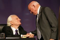 Remembering Chick-fil-A Founder Truett Cathy  |  Billy Graham and Truett Cathy greet one another at a dinner event in Atlanta in 2006.
