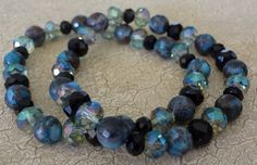 African Turquoise Black and Green Iridescent Bracelet by banujewelryusa on Etsy https://www.etsy.com/listing/243366268/african-turquoise-black-and-green