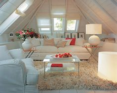 Neutral Room with Coral Accents and Vaulted Ceilings