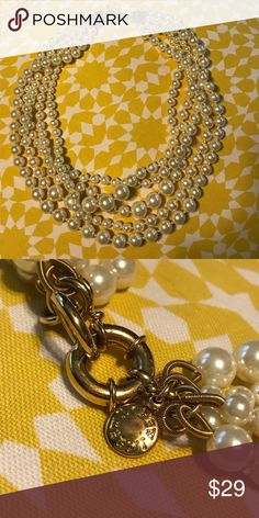 NWOT J. Crew multi strand twisted pearl necklace This gorgeous, iconic J. Crew multi strand pearl necklace really stuns in 5 strands of pearly goodness. A great combination of wholesomeness and modern feminine prowess, this necklace transforms an outfit in no time. Never worn, but tags have been removed. In perfect condition and ready to enhance your wardrobe! Nonsmoking home. 💕 Thanks for looking! 💕 The first photo is with flash. The other two are without flash. J. Crew Jewelry Necklaces