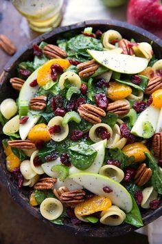 A simple autumn crunch pasta salad with crunchy apples, celery, and toasted pecans, chewy dried cranberries, sweet mandarine oranges.