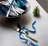 Tying silverware with bows, simple yet elegant in my opinion.  I'll have to remember for this Christmas
