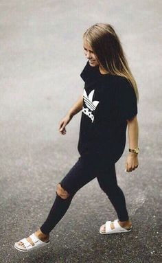 Black on black | casual outfit ideas for street style look | adidas branded shirt with ripped black skinny jeans | white birkenstocks