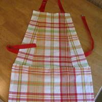 http://www.curbly.com/users/DIY-Maven/posts/4804-How-to-turn-2-napkins-into-1-FABULOUS-apron-