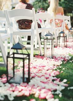 pink rose petals + lanterns lining the ceremony aisles | Landon Jacob #wedding. I like the idea of just having a pile of petals around each lantern, rather than down the whole aisle. I rent silver lanterns for your ceremony!