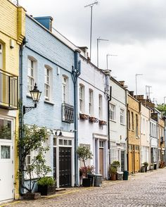 Mews with pretty pastel houses in South Kensington, London
