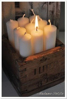 Dollar store emergency candles and a wooden box!