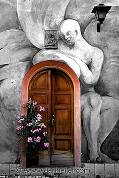 Door surrounded by art in Dozza, Italy • Dan Heller Photography