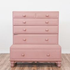 This highboy dresser is featured in a solid wood painted in a glossy dusty pink finish. This tall dresser is in great condition with 6 drawers in varying sizes, simple knobs and a small chip on one of the drawers. Eclectic storage piece!   #shabbychic #dressers #talldresser #sandiegovintage #vintagefurniture