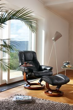 I want one of these.  They are the most comfortable thing ever. Leather Recliner chairs | Stressless