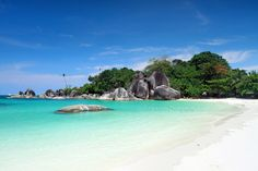 """Tanjung Tinggi"" Beach    Located at North of West-Belitung island, Bangka-Belitung province.  Clean sands, water, with big rocks."