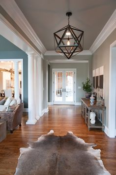 not a fan of the animal rug, but I love the molding and painted ceilings