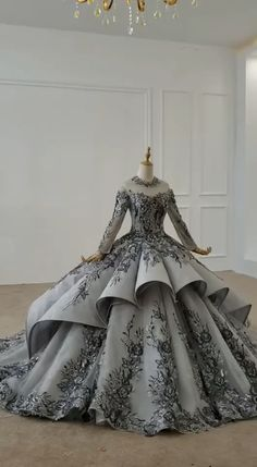 Haute Couture Gray Floral Ball Gown Long Sleeve Quinceanera Dresses Vintage grey floral lace ball gown prom dress - - Grey lace ball gown with flounced overlay - Modest high neck ball gown - Beaded lace bodice - Built-in Bra - Corset back Long Sleeve Quinceanera Dresses, Pretty Quinceanera Dresses, Pretty Prom Dresses, Amazing Dresses, Ball Gowns Evening, Ball Gowns Prom, Ball Gown Dresses, Lace Ball Gowns, Elegant Ball Gowns