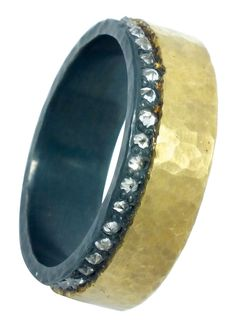 Band in 18k yellow gold and silver bead-set with 0.45 ct. t.w. inverted diamonds; $1,540; TAP Studio, Cleveland;