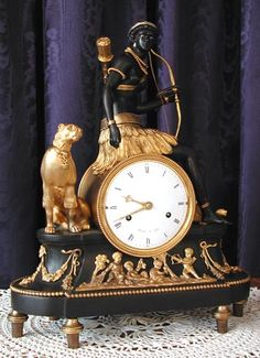 Antique clocks - Pendulantic, french mantle or mantel clock called pendule au negre or au bon sauvage or blackamoor clock, chasseresse with original enamel eyes