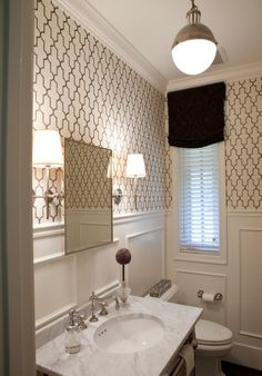 Stylish statement made with millwork. Applying narrow strips of moulding to suggest panels is a common treatment known as picture framing. Frame sizes may vary depending on the layout of your room. The key to great design is to keep the spacing between frames uniform and the edges aligned.