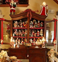 China cabinet full of Santas (from Bargain Hunting and Chatting with Laurie)